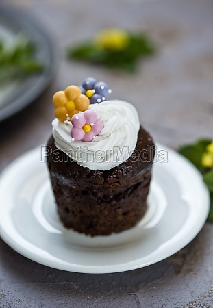 chocolate cupcake with flowers decoration