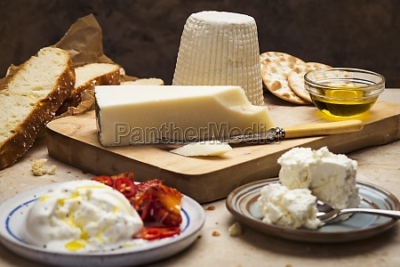 a cheese platter with olive oil