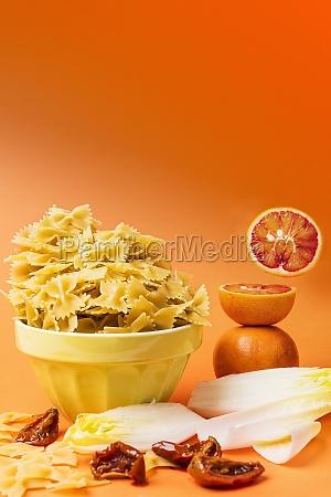 an arrangement of farfalle blood oranges