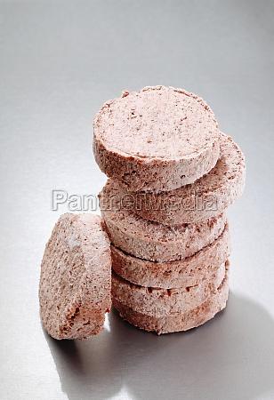 stacked frozen hamburger patties