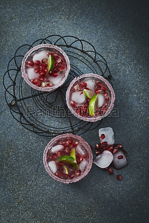 gin and tonic with pomegranate seeds