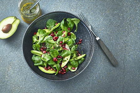 corn salad with avocado and pomegranate