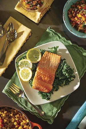 steelhead trout on bed of lettuce