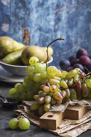 fresh ripe grapes on wooden cutting
