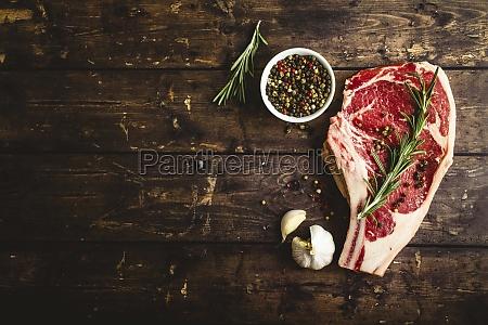 raw marbled meat steak pepper herbs