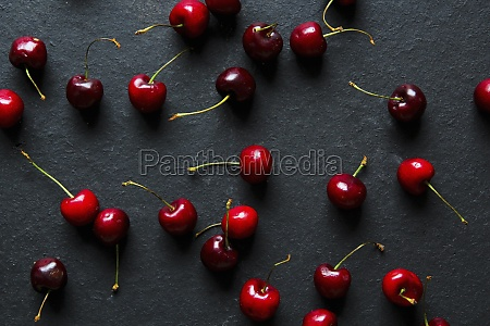from above bright red appetizing cherries
