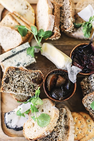 a cheese platter with bread and