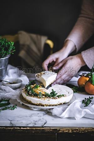 white creamy tasty tangerine cake decorated