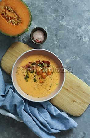 orange melon cold soup with jamon