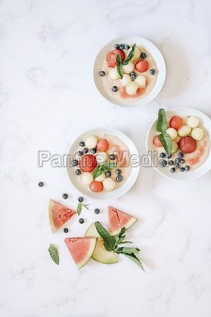 semolina pudding with melon and blueberries