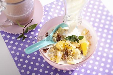 muesli with oats pineapple apple oranges
