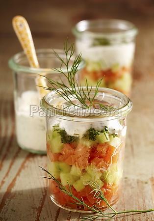 layered salad in mason jars with
