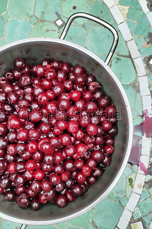 stoned cherries in a pot