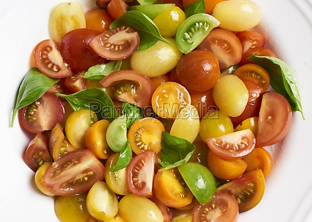 colourful tomato salad with basil
