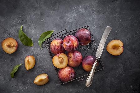 fresh plums in dark background