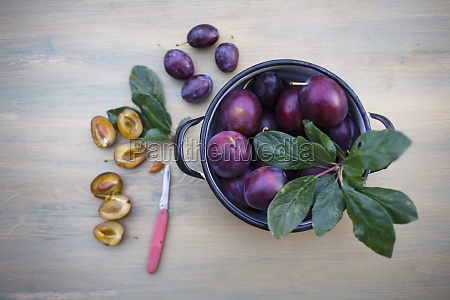 fresh plums in a pot and