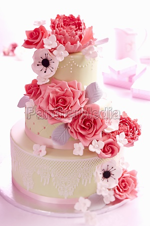 a wedding cake with roses and