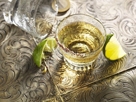tequia shot with lime wedges