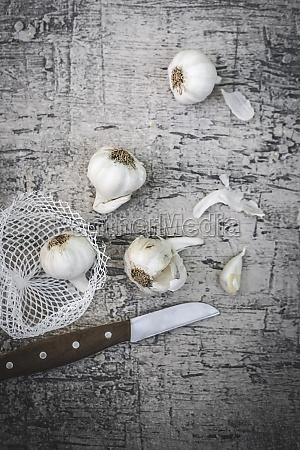 garlic bulbs with net and knife
