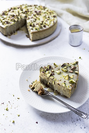 pistachio cheesecake with white chocolate served