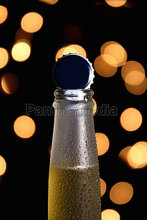 bottleneck of cold beer with shiny