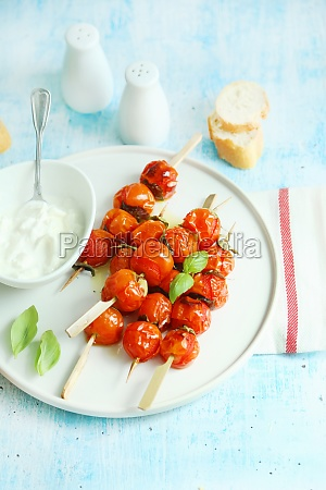 roasted cherry tomato skewers served with