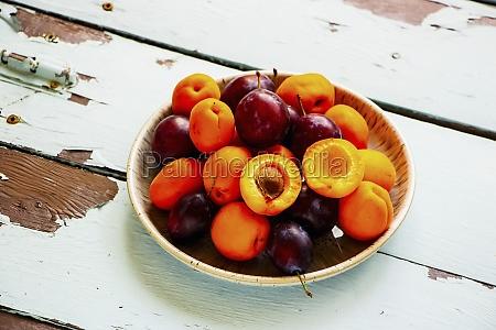 organic summer fruit on wooden table