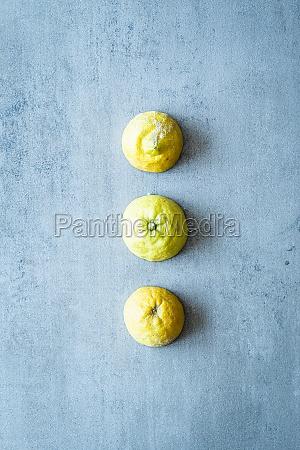 a row of three halved lemons