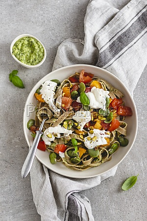 tagliatelle with courgette broad beans tomatoes