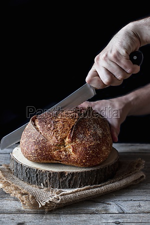 unrecognizable person using knife to cut