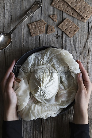 overhead crunchy crackers and spoon placed