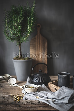 composition of black teapot and white