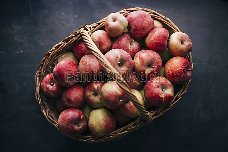 fresh red apples on dark table