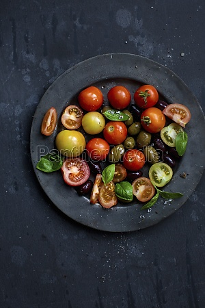 a tomato salad with olives and