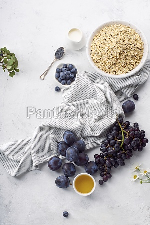 healthy breakfast with oats plums and