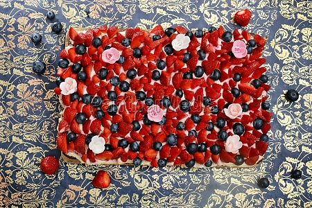 strawberry and blueberry cake with flowers