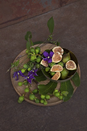 fresh figs fig twigs and clematis