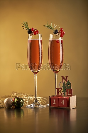 pair of glasses of red cocktail