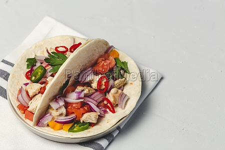 homemade mexican tacos with fresh vegetables