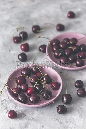 fresh cherries on plates