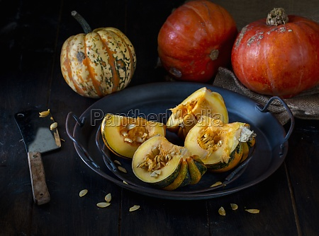 pumpkins and squashes with squash cut