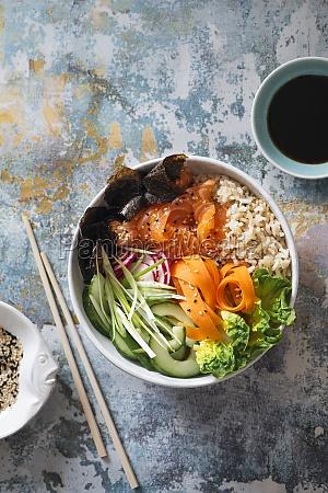 sushi buddha bowl with salmon brown