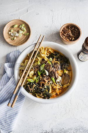spicy noodles soup with spinach and