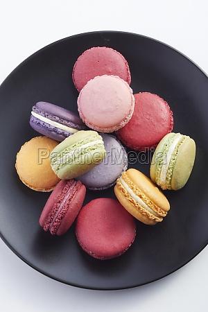 macarons on a black plate