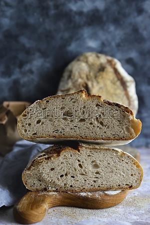 a halved loaf of sourdough bread