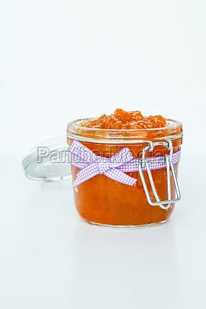 homemade jam jar of peaches with