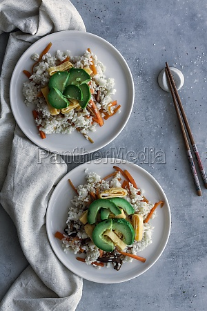 white rice with vegetables in plate
