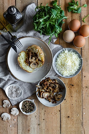 stuffed potato on wooden table with