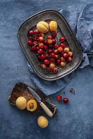 cherry and apricots served on plate