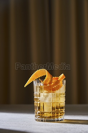 glass cup with cold old fashioned